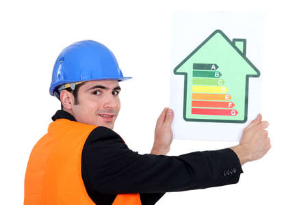 thrift: Man holding energy rating card Stock Photo