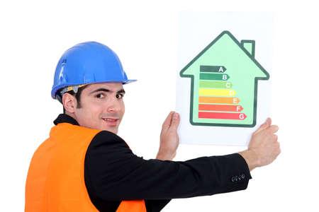 energy rating: Man holding energy rating card Stock Photo