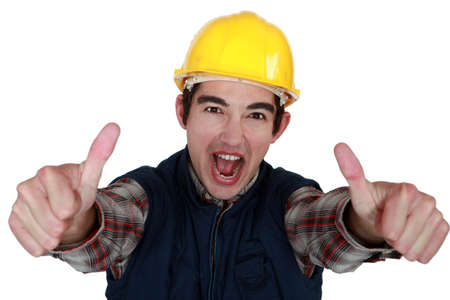Builder giving thumbs-up gesture Stock Photo - 13713593