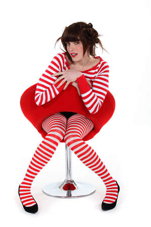 publicity: woman on red chair Stock Photo