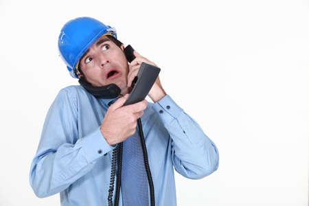 disorganized: Man juggling several phone calls