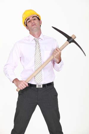 audacious: businessman holding a pickax