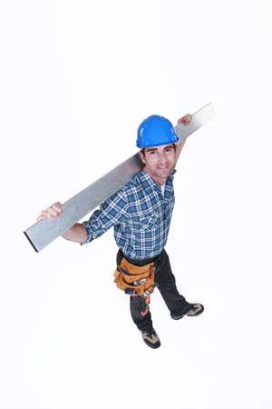 journeyman technician: high angle shot of carpenter all smiles Stock Photo