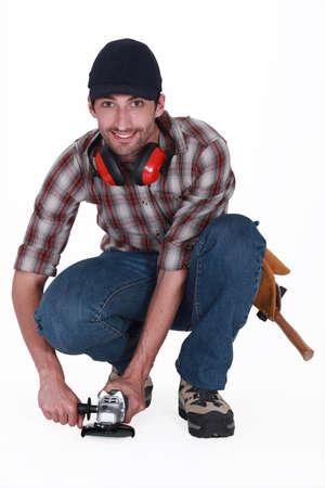mr: A handyman using a sander