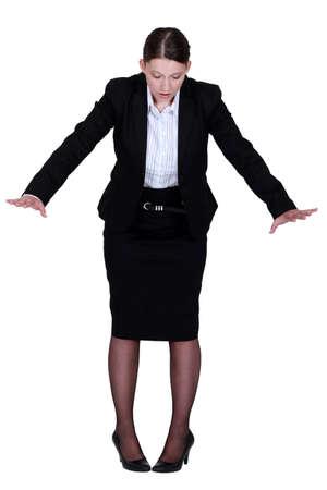 Businesswoman on the edge photo