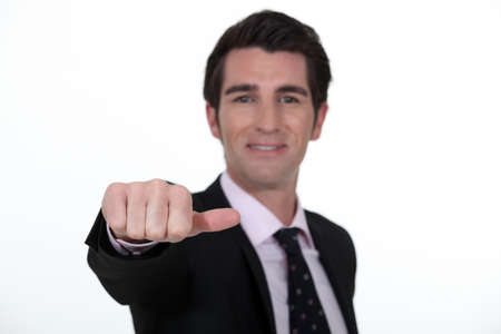 incertitude: Businessman sticking out his thumb
