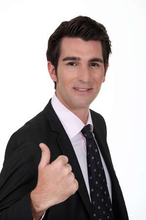 non verbal communication: Smiling businessman giving the thumb Stock Photo