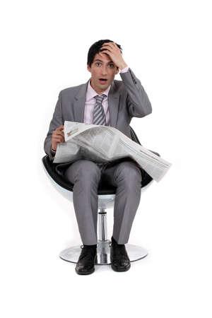 A businessman reading bad news  photo