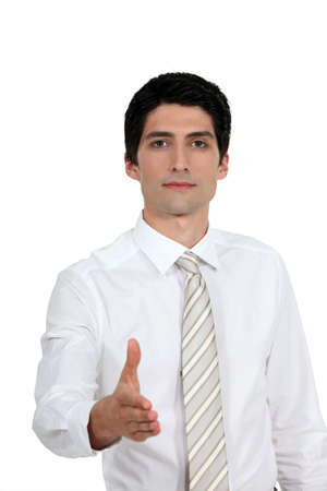 Businessman about to shake hand  Stock Photo - 13713505