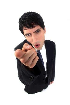 Businessman shaking his finger in anger photo