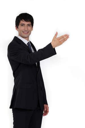Businessman with arm stretched photo