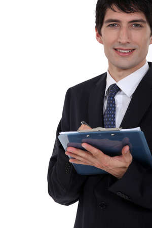 business attire teacher: Man with clip-board taking notes Stock Photo
