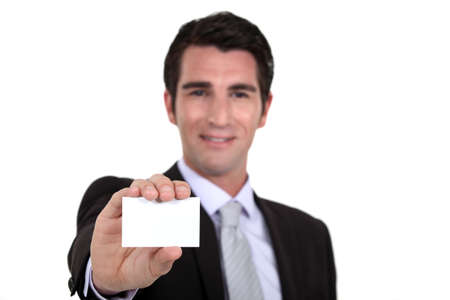 personalised: Man holding out his business card