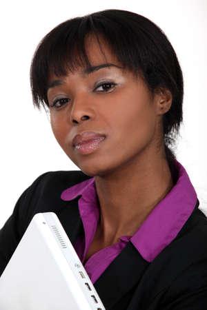 possessive: Businesswoman holding laptop