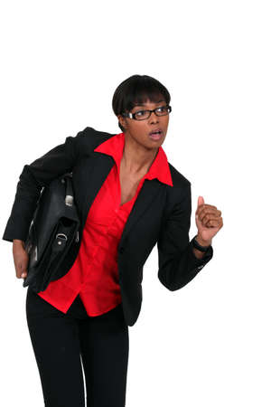 Businesswoman with briefcase about to run photo