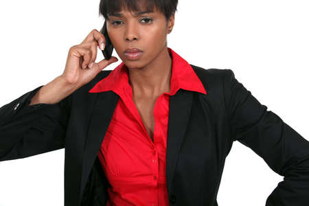 long faced: black businesswoman on the phone