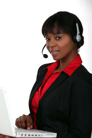 Businesswoman with a laptop and headset Stock Photo - 13713697