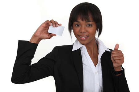 An African American businesswoman with her card  photo