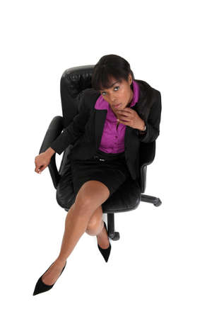Pensive businesswoman sat in office chair Stock Photo - 13713889