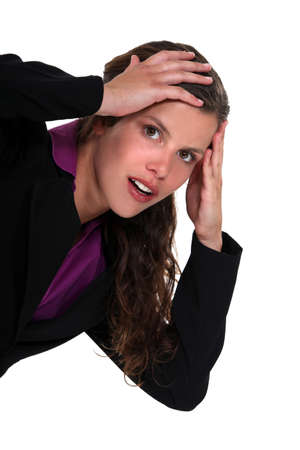 Shocked businesswoman with hands on head Stock Photo - 13713628