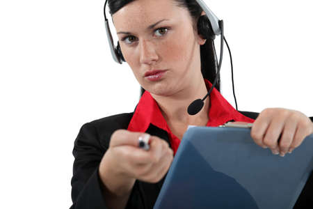 Woman with a headset and clipboard photo