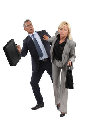 businesswoman pushing a colleague photo