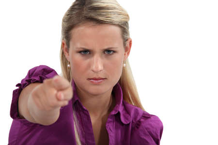 accuser: Angry woman pointing her finger Stock Photo