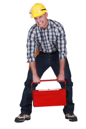 Craftsman lifting heavy tool box photo