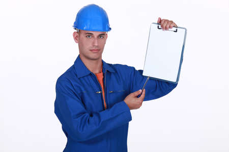 craftsman holding a notepad Stock Photo - 13713096