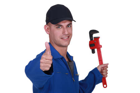 Thumbs up from a man with a wrench photo
