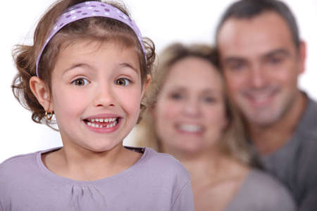 A cute little girl with her parents in the background Stock Photo - 13712514