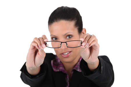 young woman trying her glasses Stock Photo - 13713785