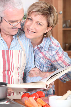 Mature couple cooking together photo