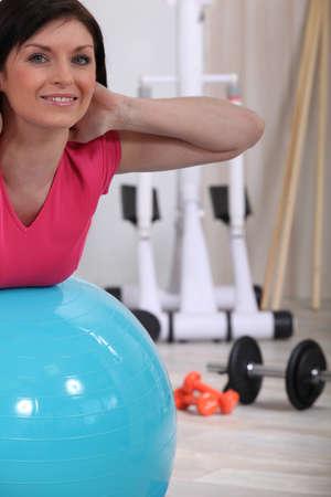 exercitation: Woman using a gym ball