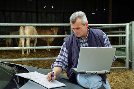 farmer's: Farmer with a laptop