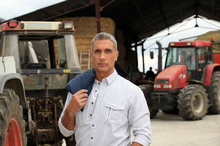 robust: A farmer posing with his tractors