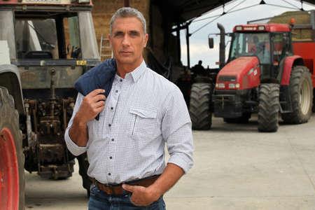 ranching: Agricultores con tractores Foto de archivo