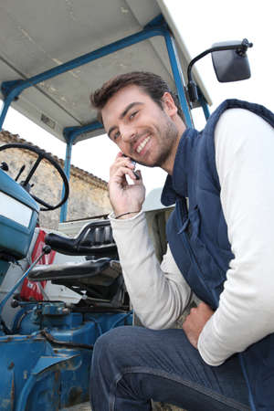 farmer's: A young farmer telephoning