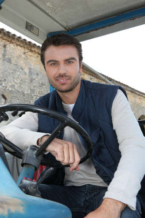 french countryside: Man driving a tractor Stock Photo
