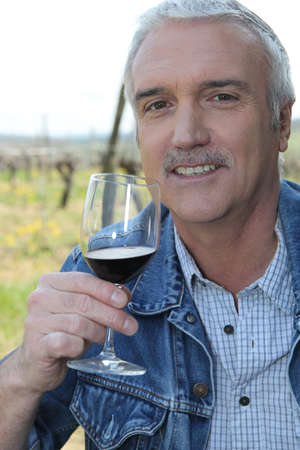 Man with glass of red wine photo