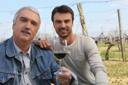producers: Wine producers in vineyard Stock Photo
