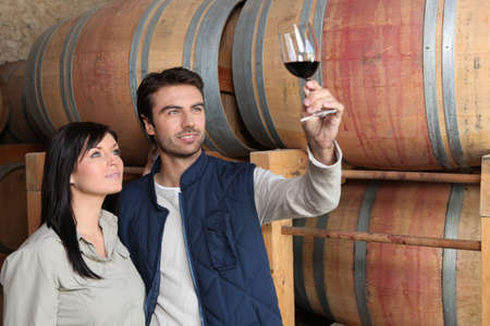 growers: couple of wine growers in wine storehouse Stock Photo