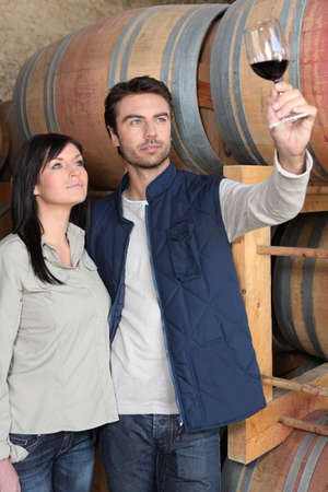 couple tasting wine in a cellar photo