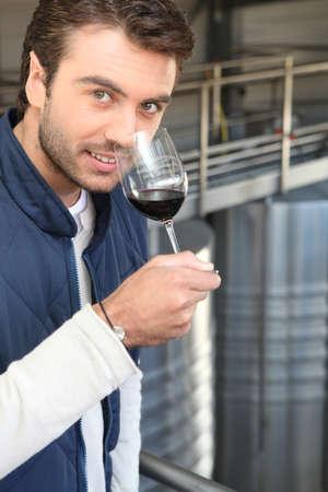 Man smelling aroma of wine photo