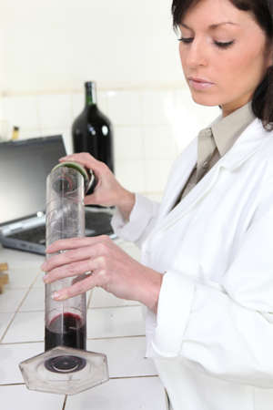 Oenologist analysing a wine Stock Photo - 13803440