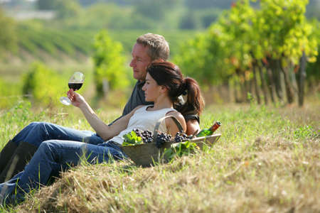 Couple tasting wine at a vineyard photo