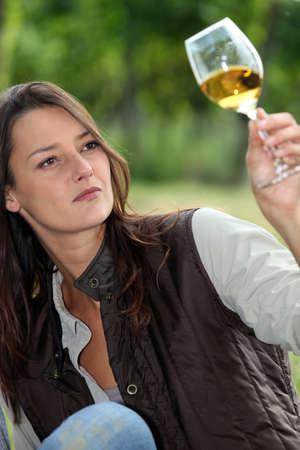 winemaker watching glass of wine photo