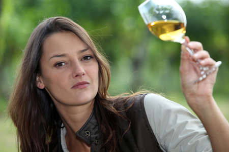 Woman looking glass of wine Stock Photo - 13770947