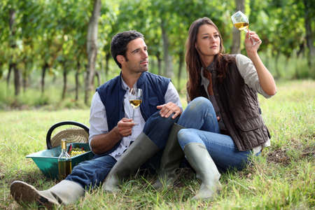 Couple of winegrowers with glasses of wine photo