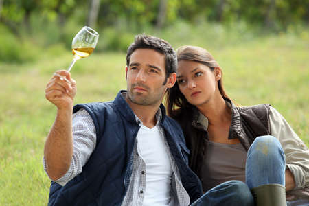 young couple tasting their wine production photo